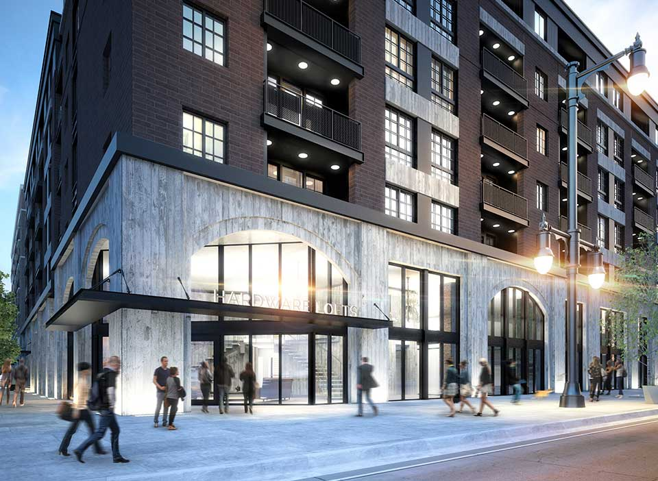 Rendering of Hardware District entrance with concrete and brick facade and tall metal street lamps.