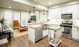 Kitchen and living space with wood floors, stainless steel appliances, and smooth countertops.